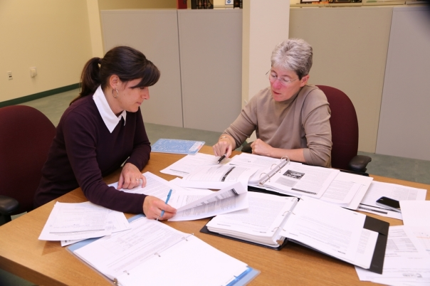 Pictured Left to Right, Amy Ramirez and Edie Schaffer working on the 2014 HMP.